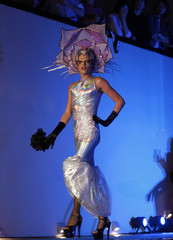 A man in drag presents his wedding dress during a same-sex wedding dress fashion show in Buenos Aires