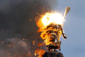 The Boeoegg, a snowman made of wadding and filled with firecrackers, explodes atop a bonfire in the Sechselaeuten square in Zurich
