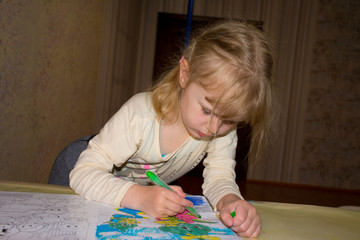 child decorates a picture