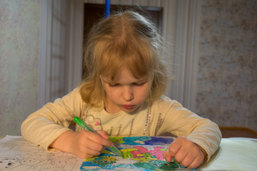 child decorates a picture