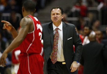 North Carolina State Wolfpack head coach Mark Gottfried gives his players instructions against the Virginia Cavaliers during a college basketball game in Atlanta