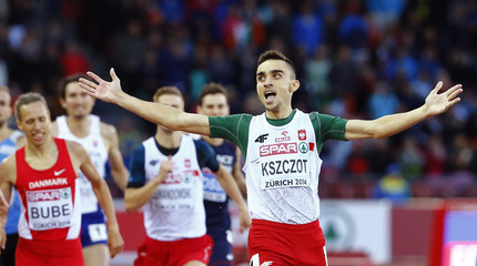 Kszczot of Poland celebrates as he crosses the finish line to win the men's 800 metresfinal during European Athletics Championships in Zurich