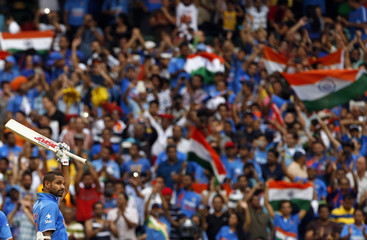India's Shikhar Dhawan celebrates after reaching his century during the Cricket World Cup match against South Africa at the MCG