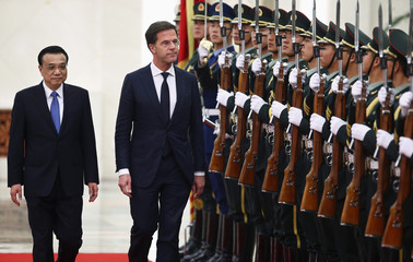 Netherlands' Prime Minister Rutte and China's Premier Li inspect honour guards during a welcoming ceremony at the Great Hall of the People in Beijing