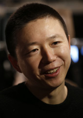 Designer Haizhen Wang talks to Reuters during an interview backstage before the presentation of his Haizhen Wang Autumn/Winter 2013 collection during London Fashion Week