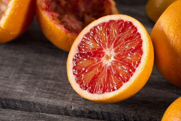 Blood Orange Half on Wooden Table