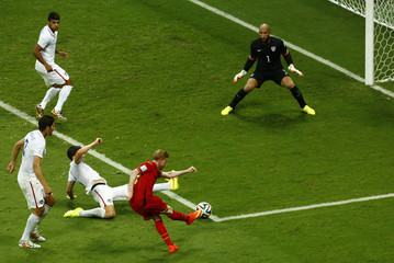 Belgium's De Bruyne kicks to score a goal against Belgium during extra time in their 2014 World Cup round of 16 game at the Fonte Nova arena in Salvador
