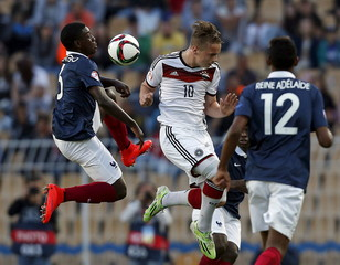 France's Makengo fights for the ball with Germany's Schmidt during their UEFA European Under-17 Championship final match in Burgas