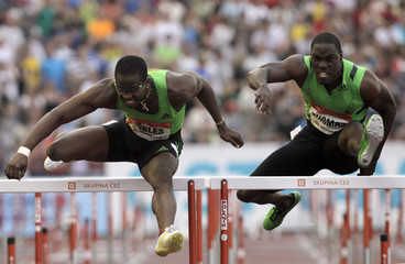 Robles of Cuba and  Thomas of Jamaica competes in men's 110m hurdles race at the IAAF World Challenge Ostrava Golden Spike meeting in  Ostrava
