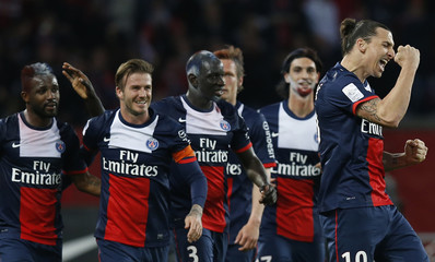 Paris Saint-Germain's Ibrahimovic celebrates with team mates including Beckham after scoring the third goal for the team during their French Ligue 1 soccer match against Brest at the Parc des Princes stadium in Paris