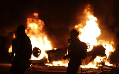 A car burns during a protest in downtown Rio de Janeiro