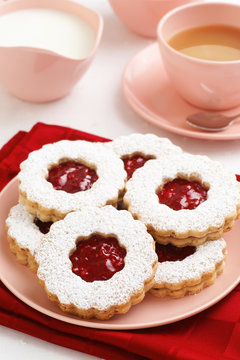 Raspberry Jam Filled Linzer Torte Cookies with Tea or Coffee