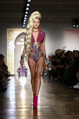 A model presents a creation from The Blonds Spring/Summer 2015 collection during New York Fashion Week