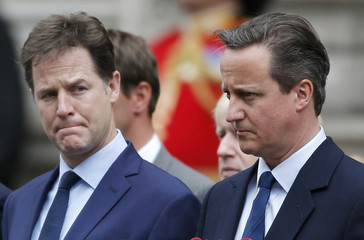 Nick Clegg, who today resigned as leader of the Liberal Democrats and Britain's Prime Minister David Cameron (R) line up to pay tribute at the Cenotaph to mark the 70th anniversary of VE Day in London