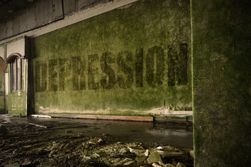 text depression on the dirty wall in an abandoned ruined house