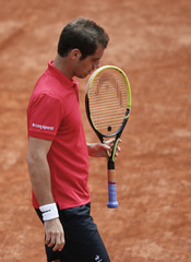 Richard Gasquet of France reacts during his men's singles match against Fernando Verdasco of Spain at the French Open tennis tournament at the Roland Garros stadium in Paris
