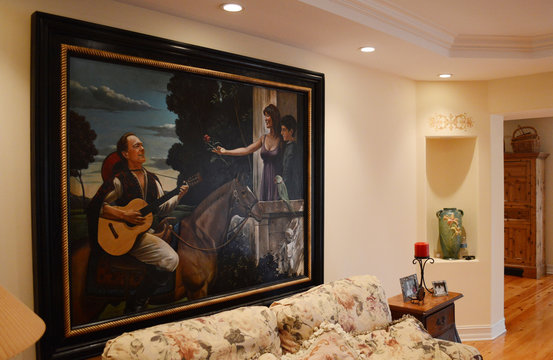 A painting former TV star and teen idol David Cassidy commissioned showing him serenading his young family hangs in a living room waterfront house that is up for auction in Fort Lauderdale