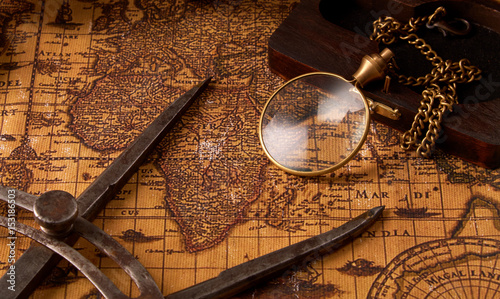 Old vintage retro compass on ancient world map  Vintage