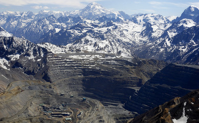 An aerial view of the open pit of Anglo American's Los Bronces copper mine with Aconcagua mount in the background