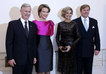 Belgium's King Philippe and Queen Mathilde pose with Netherlands' Queen Maxima and King Willem-Alexander at the Bozar concert hall in Brussels