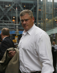 Retired NFL player Pete Kendall leaves a Manhattan law office where the NFL Players Association met with the NFL regarding labor negotiations in New York