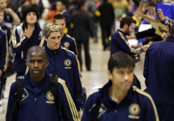 Chelsea's Fernando Torres and other players arrive at Narita International airport near Tokyo