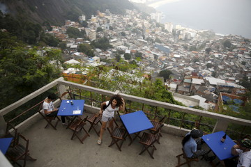 Tulin Hashemi, a Syrian, waits for a job interview at a hotel in Vidigal slum in Rio de Janeiro, Brazil