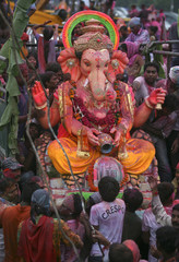 Devotees take an idol of Hindu elephant god Ganesh for immersion in Ahmedabad