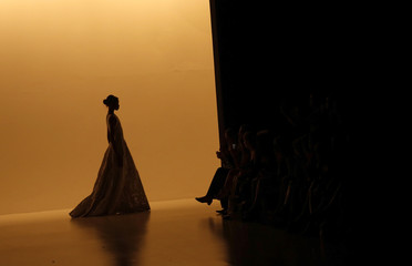 Model presents a creation from Patricia Motta's Summer 2015 collection at Sao Paulo Fashion Week