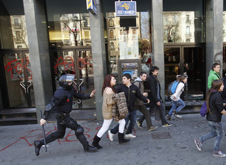 Police disperse demostrators during a protest against spending cuts in public education in Barcelona