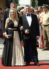 German Health Minister Groehe and his wife arrive on the red carpet for the opening of the Bayreuth Wagner opera festival outside the Gruener Huegel (Green Hill) opera house in Bayreuth