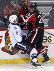 Ottawa Senators Neil hits Tampa Bay Lightning Ohlund during the first period of their NHL hockey game in Ottawa
