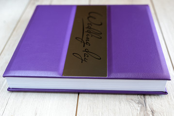 Wedding book on a wooden background