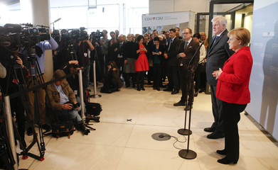 German Chancellor and leader of the CDU Merkel and Bavarian state Premier and leader of the CSU Seehofer make a statement to the media in Berlin