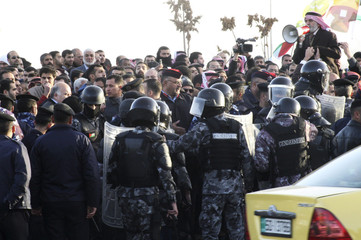 Protesters from the Islamic Action Front Party take part in an anti-government rally outside government office in Amman