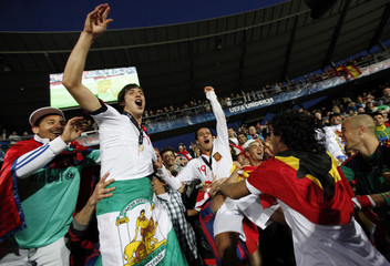 Spain's Montoya and Alcantara celebrate with fans winning the European Under-21 Championship final soccer match against Switzerland in Aarhus