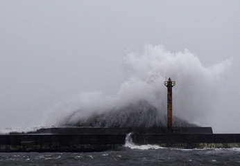 A big wave smashes into a breakwater as Typhoon Fanapi hits the northeastern coastal town of Toucheng in Ilan county