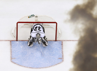Los Angeles Kings goalie Quick sits in the net as a steam from an air horn in the scoreboard wafts over announcing a New Jersey Devils goal in the first period during Game 5 of the NHL Stanley Cup hockey final in Newark