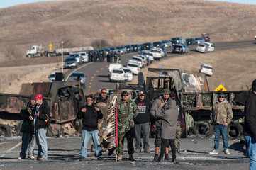 Members of the Oceti Sakowin Camp security stand guard during a protest over the Dakota Access pipeline near the Standing Rock Indian Reservation near Cannonball, North Dakota