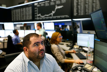 Traders react at the stock exchange in Frankfurt
