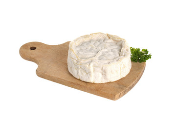 Camembert cheese on a wooden board