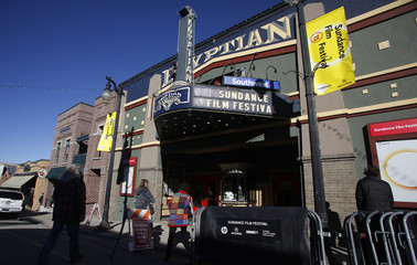 People walk pass the Egyptian Theatre before the opening day of the Sundance Film Festival in Park City, Utah