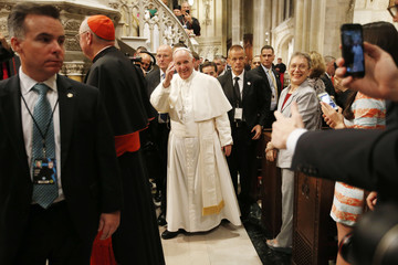 Pope Francis waves as he departs after presiding over evening prayers at St. Patrick's Cathedral in New York