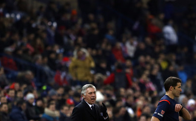 Real Madrid's coach Ancelotti gestures during their Spanish King's Cup soccer match against Atletico Madrid at Vicente Calderon stadium in Madrid