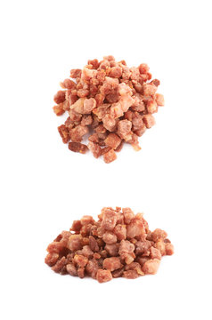 Pile of fried bacon bits isolated