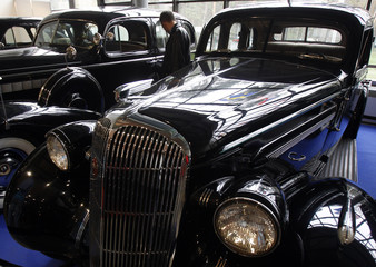 A visitor looks at a vintage at the Retro & Exotica Motor Show in Kiev
