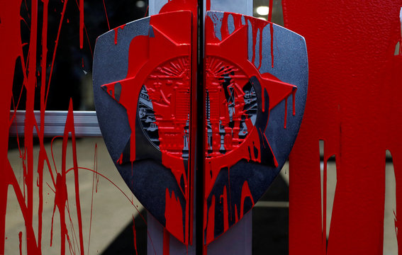 A door with handles in the likeness of the Oakland Police patch is seen splashed with red paint outside the Oakland Police headquarters during a protest against police shootings that lead to two deaths in Louisiana and Minnesota, respectively, in Oakland
