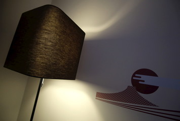 A Mt. Fuji painting is seen on a wall next to a lamp inside a hotel room at Grids at the Akihabara shopping district in Tokyo