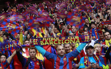 Fans of Barcelona cheer before start of Champions League final soccer match between Manchester United and Barcelona at Wembley Stadium in London