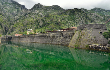 Castle moat filled with emerald water